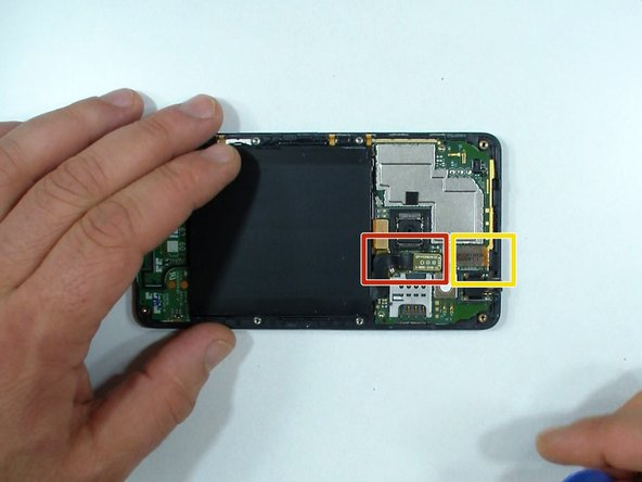 Disconnect the battery and the touch screen flex cables.