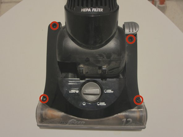 Using a Phillips #2 screwdriver, remove the four screws from each corner of the brush roll cover.
