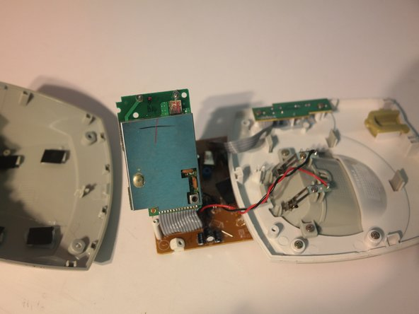 The main circuit board can be removed from the bottom case.