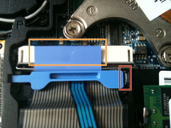 First insert a small flat head screwdriver or a spudger into the small notch in between holding down the ribbon.