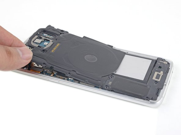 Lift and remove the wireless charging coil from the phone.