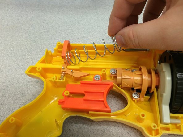 Remove the larger spring from the catch mechanism.