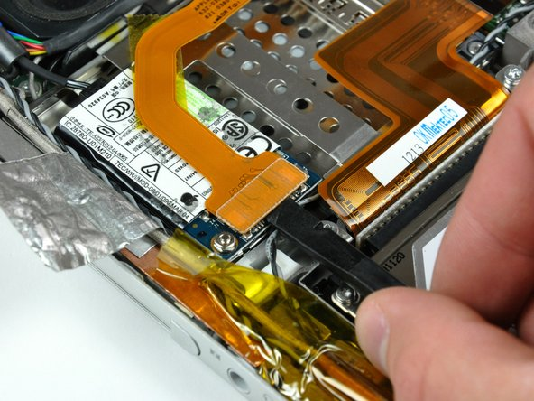 Use the flat end of a spudger to pry the modem cable connector up off the modem.