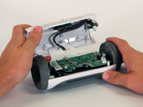 Place the battery into the new white casing.