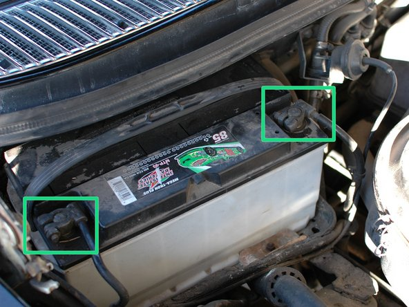 Start by disconnecting both battery terminals, beginning with the negative (-) side, which travels just a few inches to a bolt attaching the other end to the car's body.