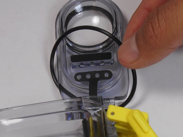 Now that the O-ring is out of the groove, remove the O-ring from the lid.