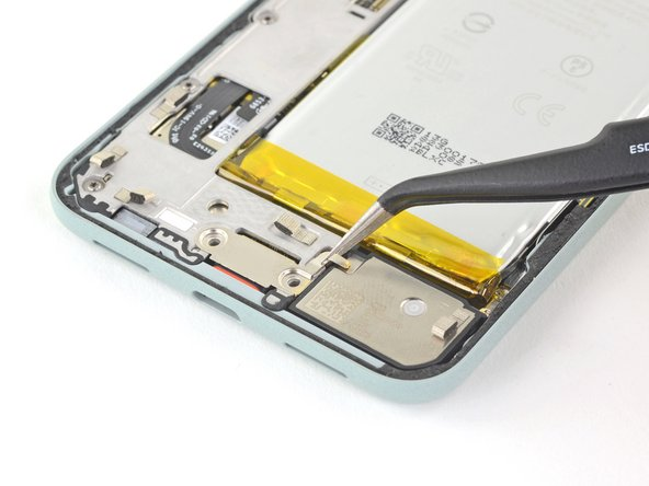 Use tweezers to remove the charging plate cover.