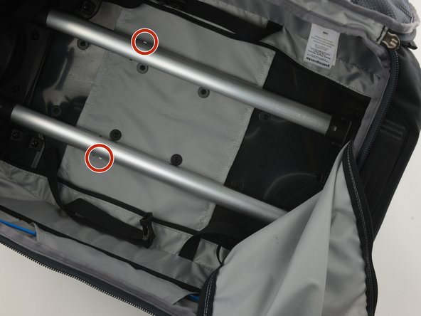 If you are having trouble with your handle, check the pins inside the bag.