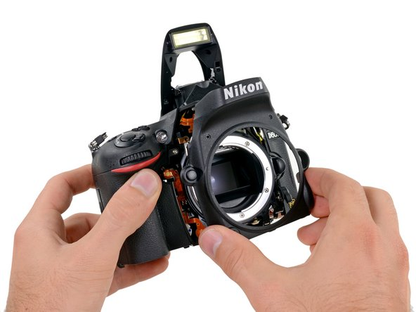 The front case is the next piece to surrender its spot on the D600's body.