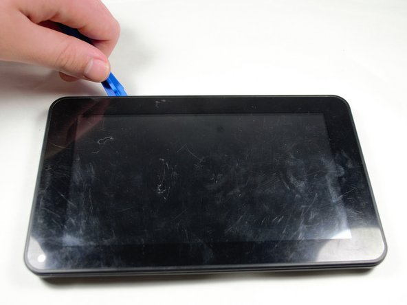 Remove the back of the device using the Plastic Opening tool by placing it between the front and back panel and gently prying them apart.