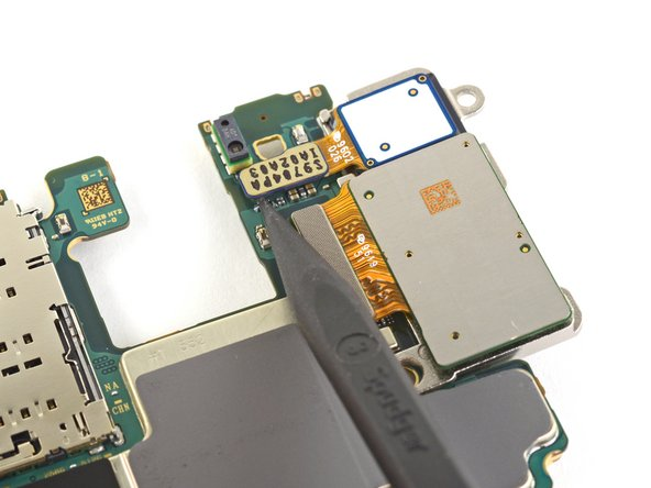Use the pointed end of a spudger to disconnect the top camera connector from the motherboard.
