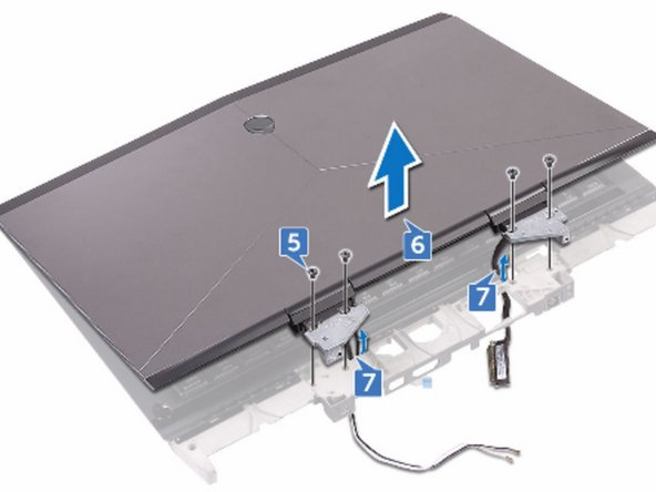 Remove the cables from the routing holes on the palm-rest assembly.