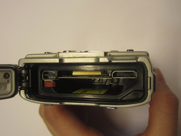 Open the side panel and check for any obstructions in the battery slot.