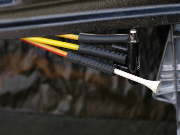 The lock and unlock lines that connect to the switch travel back out of the door and then in to the interior of the car to provide vacuum to those two branches of the system, depending on the position of the switch.