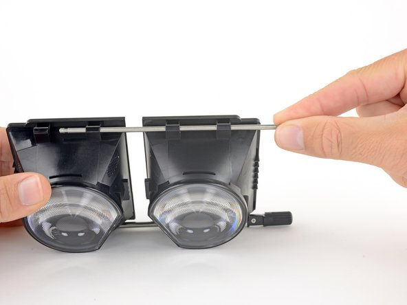 Slide the support rod out of its brackets on the lens and OLED frames.