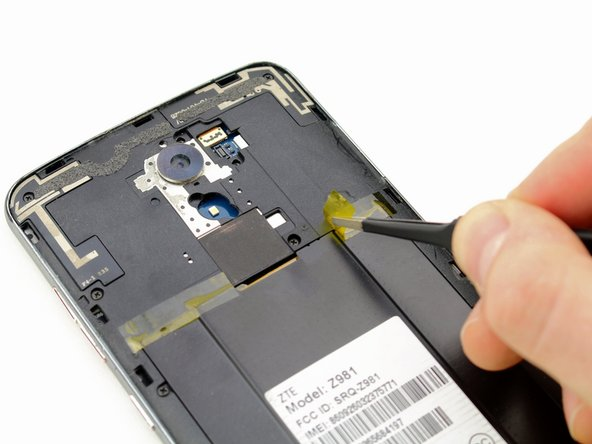 Using the tweezers, peel back the yellow Kapton tape located on the right side of the phone.