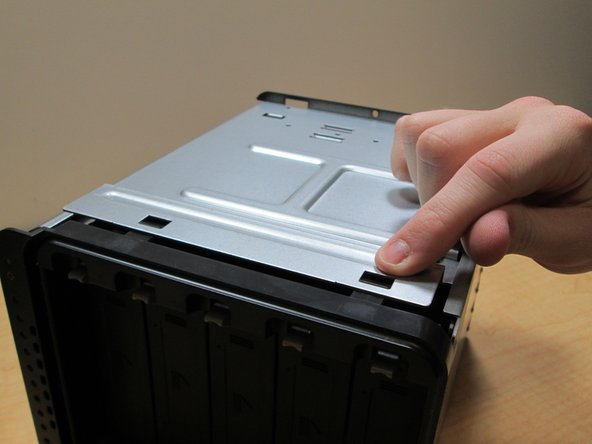 Then do the same to the other side, pushing the pins down.  Then slide the hard drive docks out.