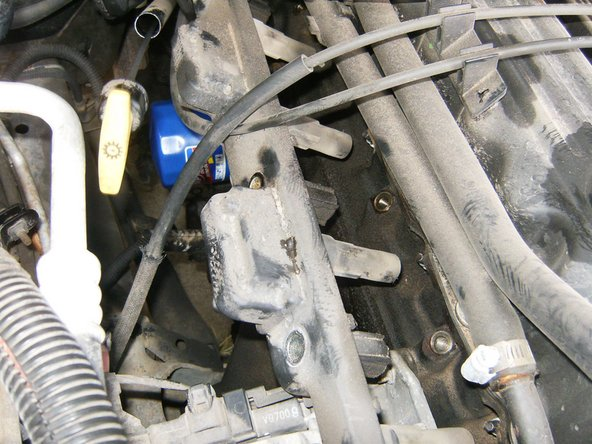 With all 4 bolts removed, the rail should easily pull off the spark plugs.  One electrical connector (located at the rear end of the coil rail) is used for all three coils. It is not necessary to totally remove the rail for a spark plug change.