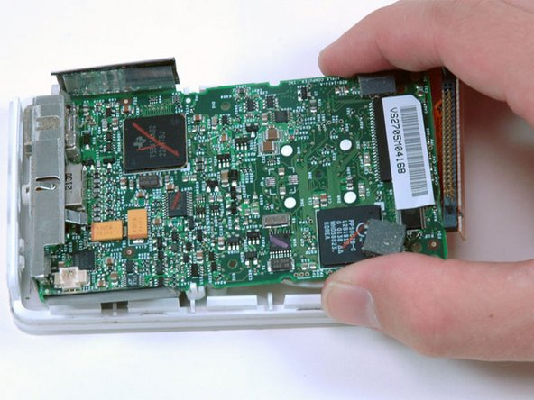 Slide the logic board away from the port end of the casing and lift it out of the iPod.