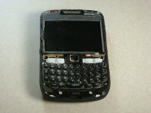 The keyboard should slide off of the phone now that the plastic siding has been removed.
