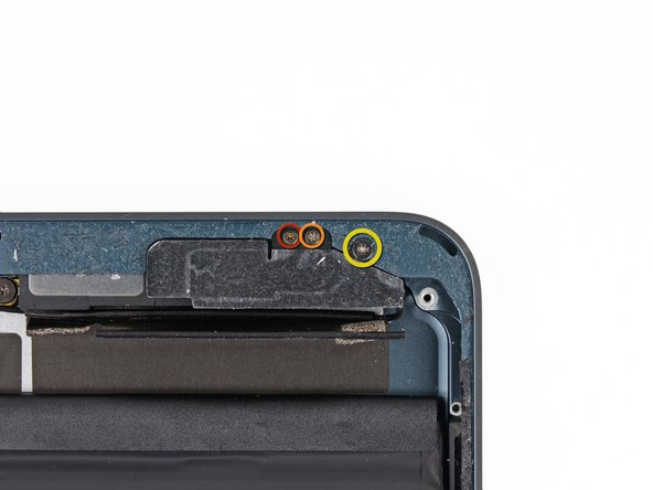 Remove the following three screws securing the Wi-Fi/Bluetooth antenna to the rear case: