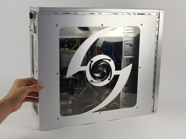 Next, remove the side panel of the computer case to allow access into the computer. Slide the panel towards the back of the computer and lift it up to remove.