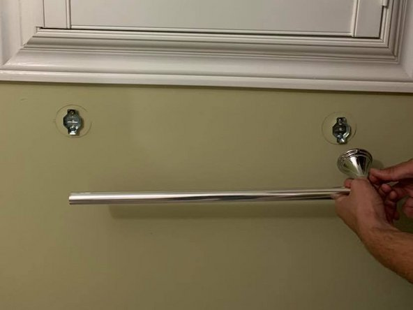 Remove the towel bar from the wall brackets.