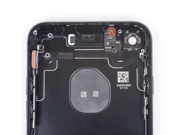 Remove the 2.3 mm standoff screw securing the flash bracket to the rear case.