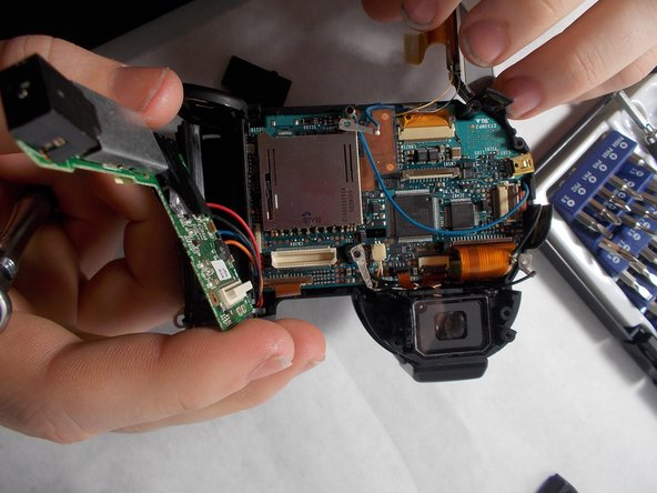 Carefully remove the circuit board from the motherboard.