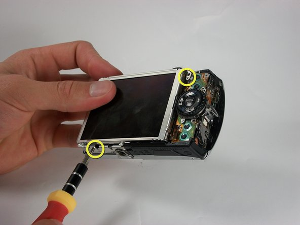 Remove the screws (2.88 mm) at the top right corner and bottom left corner of the LCD screen.