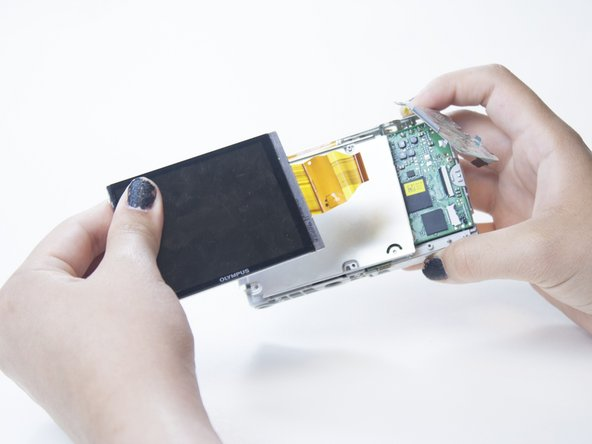Pull out the LCD screen and the ribbon cable.