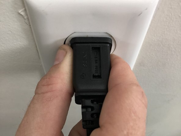 Grasp plug and remove from the receptacle or other outlet device.