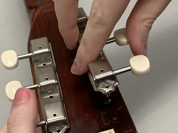 Insert the second tuning key rack into the appropriate tuning key holes.