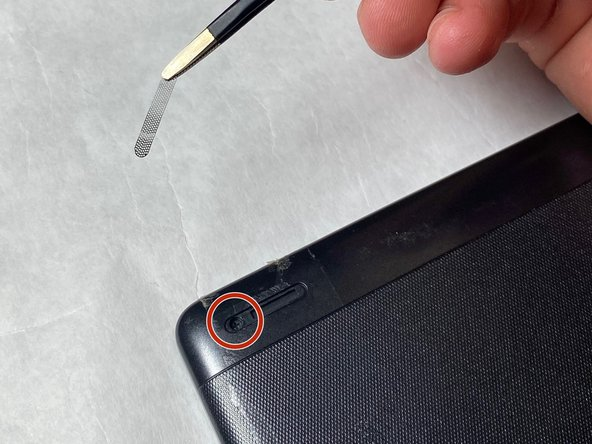 Remove the screws from both of the spots that were covered with a Phillips #000 screwdriver.