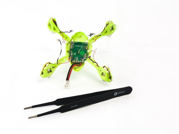 Use the tweezers to unthread the motor and LED wires from the quadcopter arms.