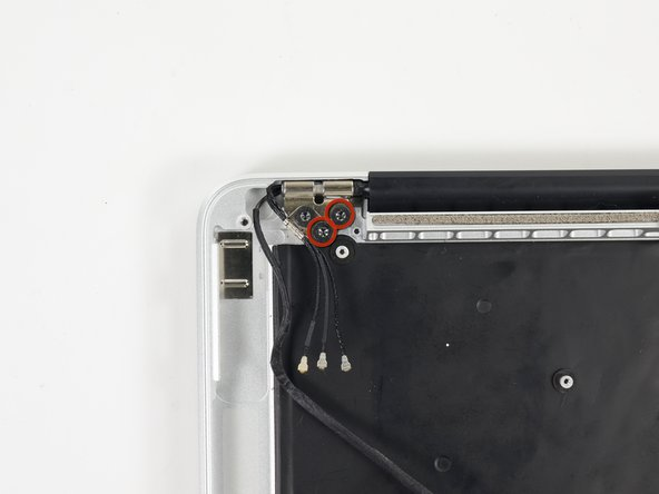 Remove the four inner 5.3 mm T8 Torx screws (two on each side) securing the display to the upper case.