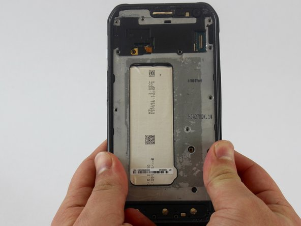 Put a little pressure on the top, on the bottom, and on the sides of the phone to separate the rear case.