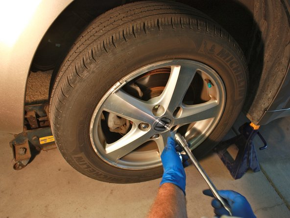 Once car is raised, remove the lug nuts on one of the front tires with the 3/4'' socket.