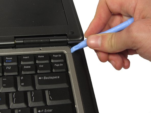 With the battery removed, turn the laptop face up and open the lid a complete 180 degrees.