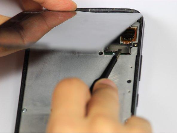 Grab the unscrewed metal plate with your blunt tweezers.