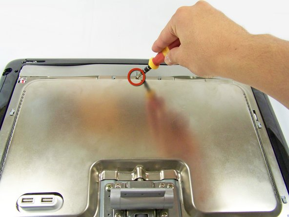 Now locate and remove the lone Phillips screw holding the EMI shield to the display