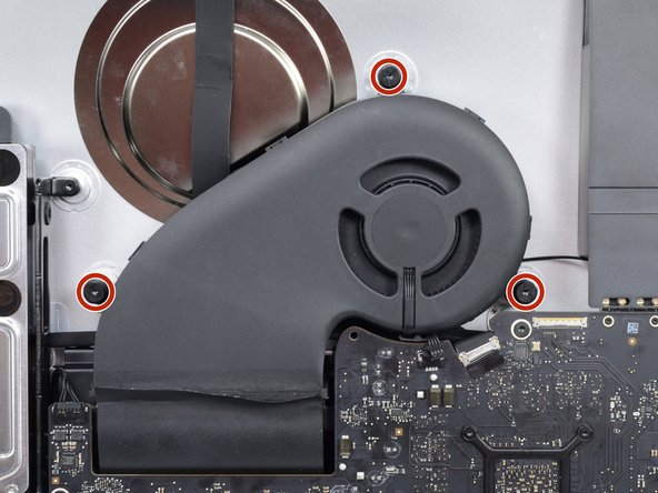 Use a T10 Torx screwdriver to remove the three 12.4mm screws securing the fan.