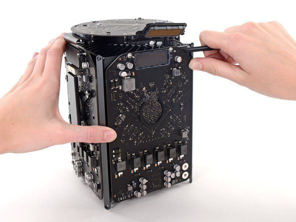 The graphics card is now held onto the central heat sink by thermal compound.