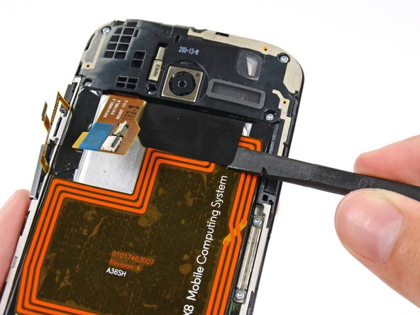 Use the flat end of a spudger to peel the adhesive pull-tab off the top of battery.