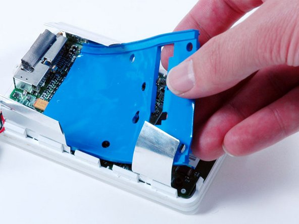 Lift the blue hard drive mounting bracket out of the iPod.