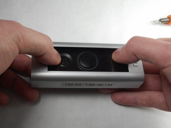 Use your thumbs to apply downward pressure on the glass part of the device while pulling the faceplate up and off of the device.