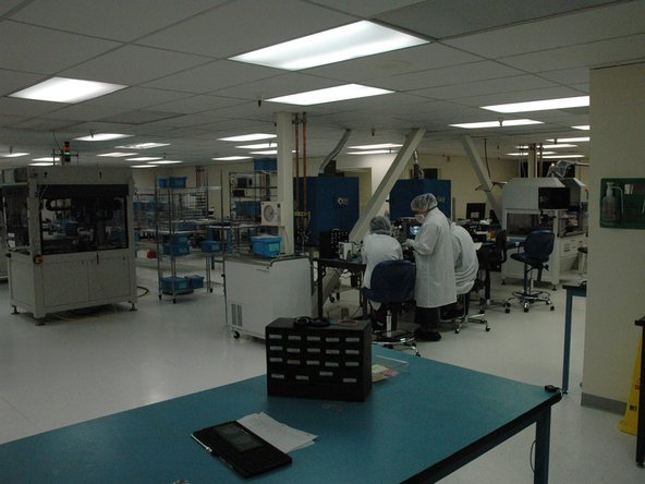 This is a typical cleanroom. Regular people—people who might even shop at the same supermarkets as you—suit up every day and go to work in rooms like these. It's absolutely imperative to keep dust, lint, and hair away from the task at hand.