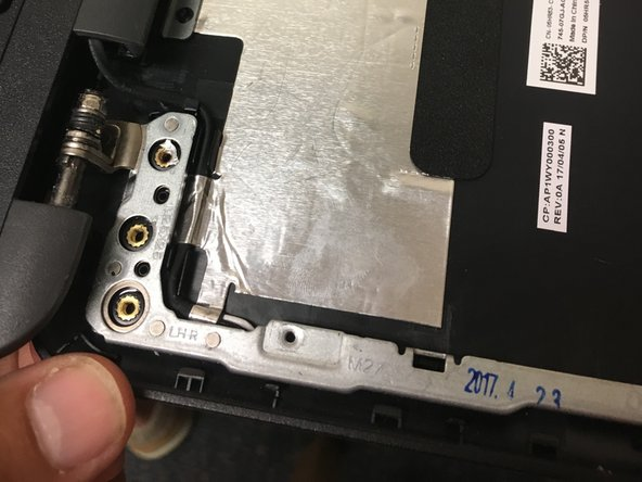 Remove the hinge/lid brackets. To do this remove the 4 black (LARGE HEAD) scres