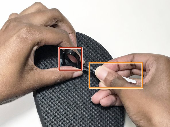 Adjust the length of the zip tie to create a snug fit between your toes.