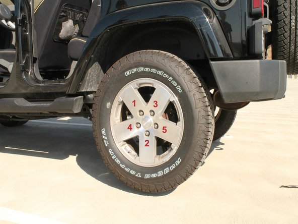 Use the lug wrench in a star pattern to properly loosen the lug nuts.  Refer to picture 1 regarding the loosening pattern.
